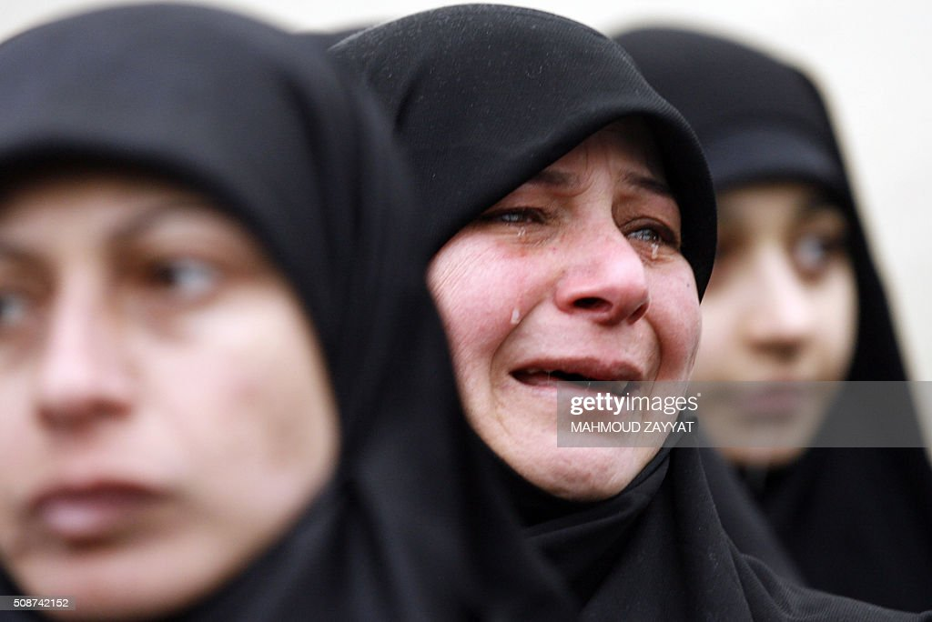 Mourners attend the funeral of Ali Ahmed Sabra, a member of Lebanon's militant Shiite Muslim movement Hezbollah who was killed in combat alongside Syrian government forces in Aleppo, on February 6, 2016, in the Lebanese village of Jibshit, about 50 kilometres south of the capital Beirut. / AFP / MAHMOUD ZAYYAT