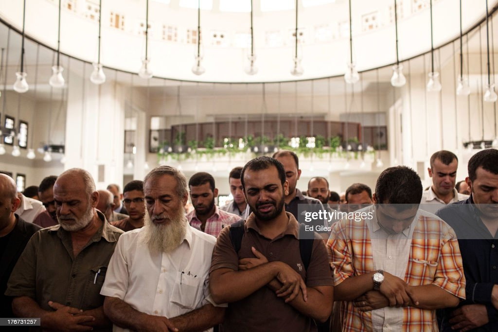 Mourners attend the funeral of Ammar Badie (38), son of the Muslim Brotherhood's Supreme Guide, Mohammed Badie at the Hammad Mosque in the New Cairo district on August 18, 2013, in Cairo, Egypt. Ammar Badie reportedly died of gunshot wounds during a protest entitled 'Day of Rage' in Ramses Square in central Cairo on Friday. Supporters of deposed Egyptian President Mohammed Morsi had gathered on Friday, August 16 at the Fateh Mosque in Ramses Square to protest the deaths of hundreds of pro-Morsi protesters killed during the clear-out of protest camps in Cairo by Egyptian Security Forces on August 14. (Photo by Ed Giles/Getty Images).