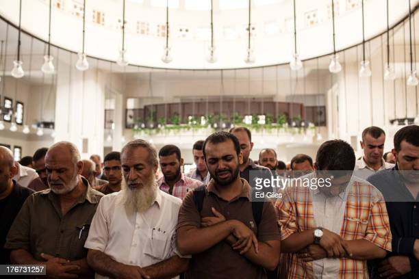 Mourners attend the funeral of Ammar Badie son of the Muslim Brotherhood's Supreme Guide Mohammed Badie at the Hammad Mosque in the New Cairo...