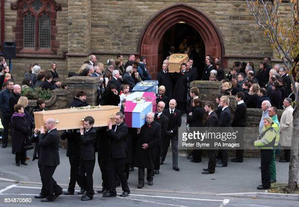 Mourners attend the funeral of David and Michelle Statham and their four children at Our Lady Star of the Sea Catholic church in Llandudno North Wales