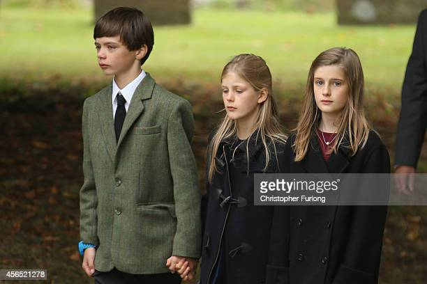 Mourners attend the funeral of Deborah Dowager Duchess of Devonshire at St Peters Church Edensor on October 2 2014 in Chatsworth England Deborah...