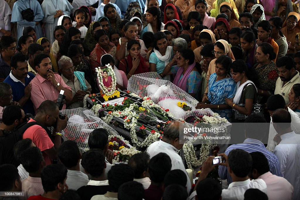 Mourners attend the funeral of H.Rosaline and her two daughters H.Goldine and H.Gloria, victims of the Air India Express plane crash, at the St. Alphonsa Catholic Church, on May 23, 2010 in Mangalore. H.Rosaline and her two daughters H.Goldine and H.Gloria were passengers of the Air India Express Boeing 737-800 series aircraft arriving from Dubai, with 166 people onboard. Airline officials say 8 survivors have been rescued with 158 others feared dead.