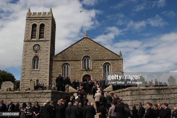 Mourners attend the funeral of Pilot and retired Police Officer Hugh McKnight at the Annalong Presbyterian church Dublin