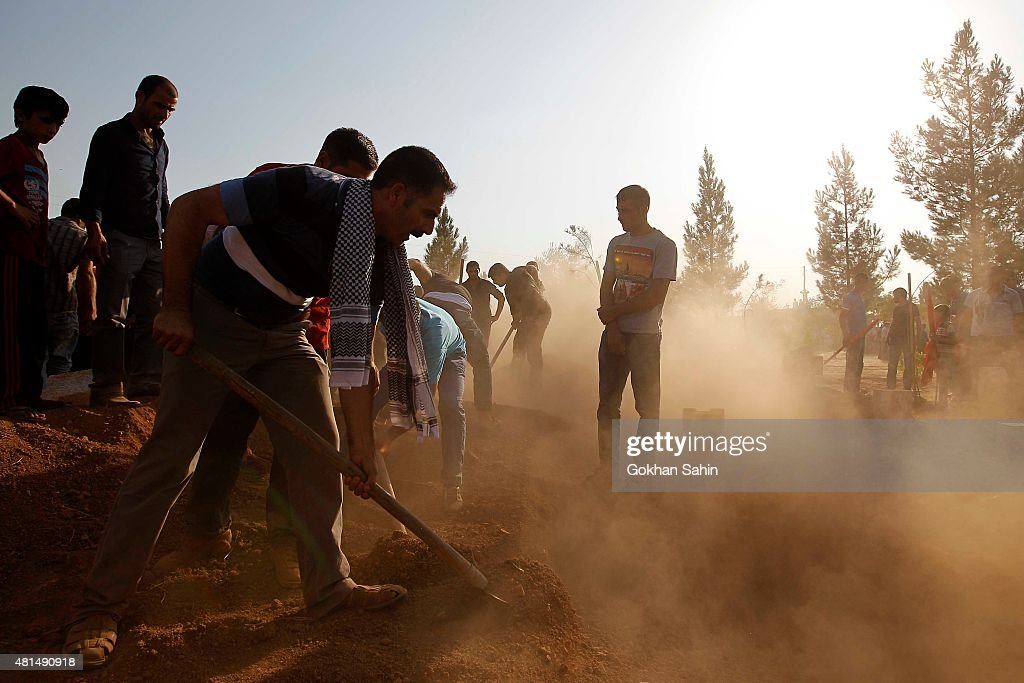 Mourners bury victims of Monday's bomb blast at a cemetery on July 21 2015 in Suruc Turkey The bomb attack in the Turkish town of Suruc killed at...
