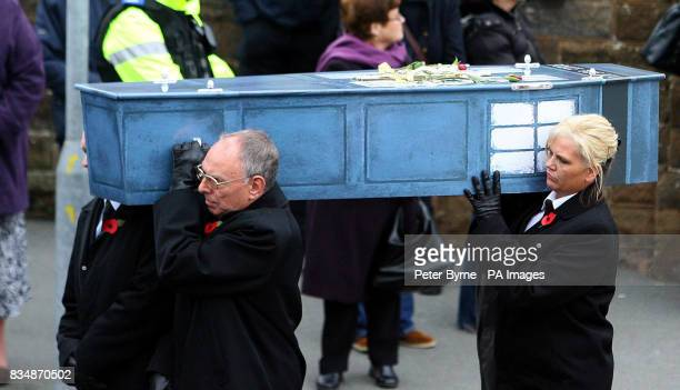 Mourners carry Jay's coffin shaped like a Tardis at the funeral of David and Michelle Statham and their four children at Our Lady Star of the Sea...