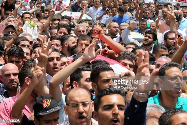 Mourners carry the body of 17yearold Mohammed Jawawdeh who was killed on the weekend when he attacked a security guard at the Israeli embassy...