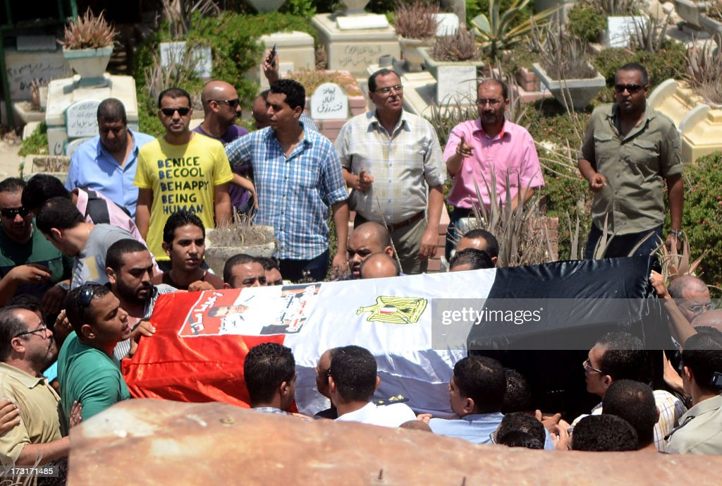Mourners carry the coffin of a police officer killed in clashes between protestors and security forces during his funral in the northern coastal city of Alexandria, on July 9, 2013. Egypt's interim leader vowed fresh elections by early next year as Islamists prepared to rally after dozens of ousted president Mohamed Morsi's loyalists died in clashes at a Cairo military barracks the day before. The Muslim Brotherhood released the names of 42 people killed in the incident, as the interior ministry and military said two policemen and a soldier were also killed.