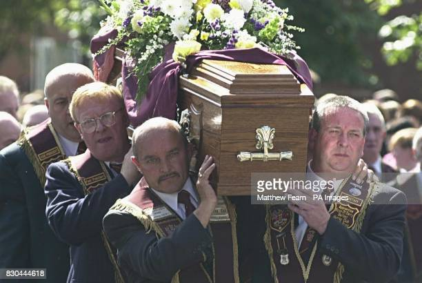 Mourners carry the coffin of Bobby Mahood from his home in Snugville Street Belfast on its way to Carnmoney Cemetary Several hundred people gathered...