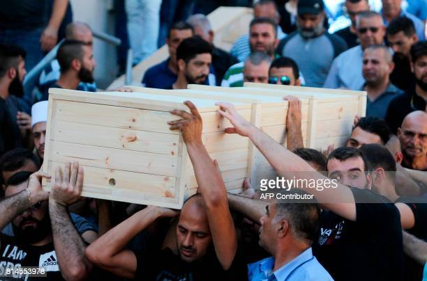 Mourners carry the coffin of Ha'il Satawi an Israeli policeman from the ArabDruze minority in the Druze village of Maghar in northern Israel on July...