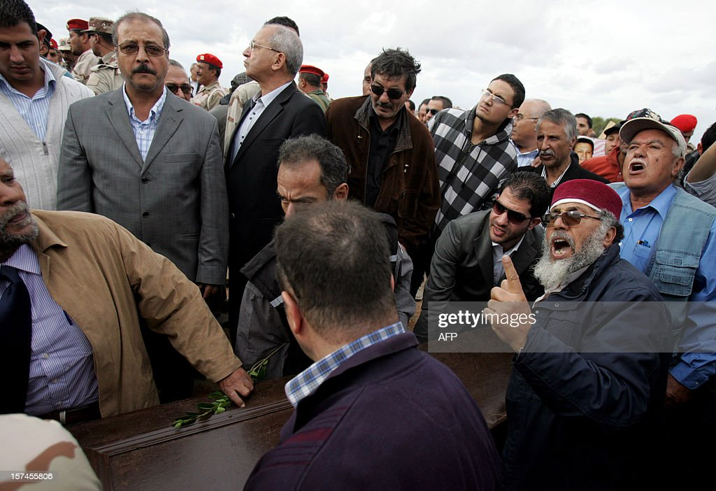 Mourners carry the coffin of leading Libyan dissident Mansour al-Kikhia during his funeral procession in the eastern Libyan port city of Benghazi on December 3, 2012. Kikhia, who disappeared 19 years ago under the Kadhafi regime, was buried, weeks after his body was found in an intelligence services morgue, his brother said. AFP PHOTO / ABDULLAH DOMA