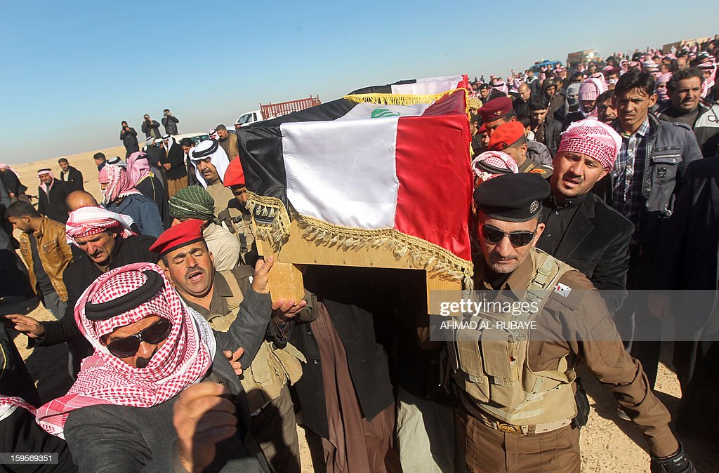 Mourners carry the coffin of MP Ayfan Saadun al-Essawi, of the secular Sunni-backed Iraqiya bloc, in the western town of Fallujah, 50 kilometers from Baghdad, in Anbar province, on January 16, 2013. Essawi, 37-years-old, was killed by a suicide bomber who wrapped his arms around the lawmaker before blowing himself up, as a political crisis engulfed Iraq.