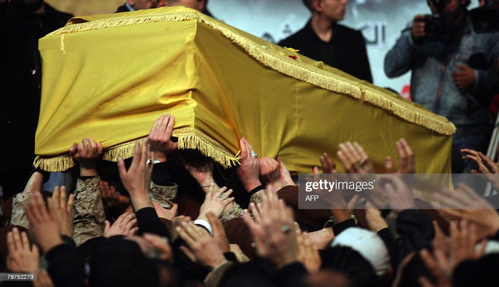 Mourners carry the coffin of slain Hezbollah leader Imad Mughnieh during his funeral in Beirut's southern suburbs on February 14 2008 Mughnieh who...