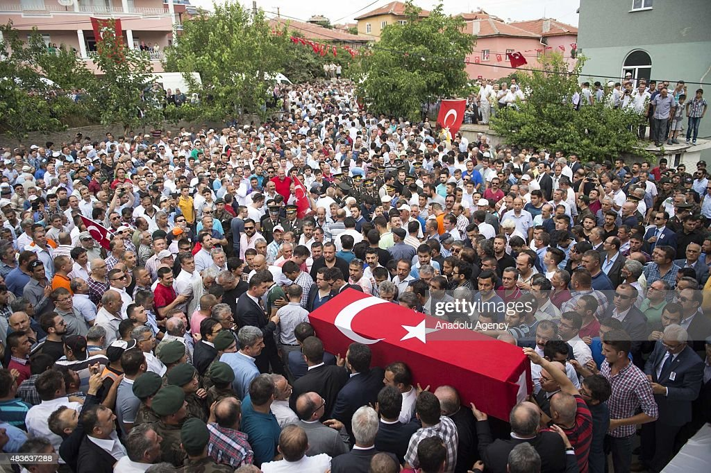 Mourners carry the coffin of Turkish police Sahin Polat Aydin who was killed in a terrorist attack in Sirnak province during a funeral ceremony in...