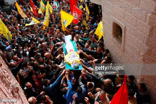 TOPSHOT Mourners chant slogans during the funeral of Murad Yussef Abu Ghazi at alAroub Palestinian refugee camp north of the West Bank town of Hebron...