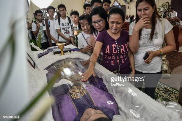 Mourners come to pay respects to activist priest Marcelito quotTitoquot Paez who was killed by unidentified assailants during his funeral wake in San...