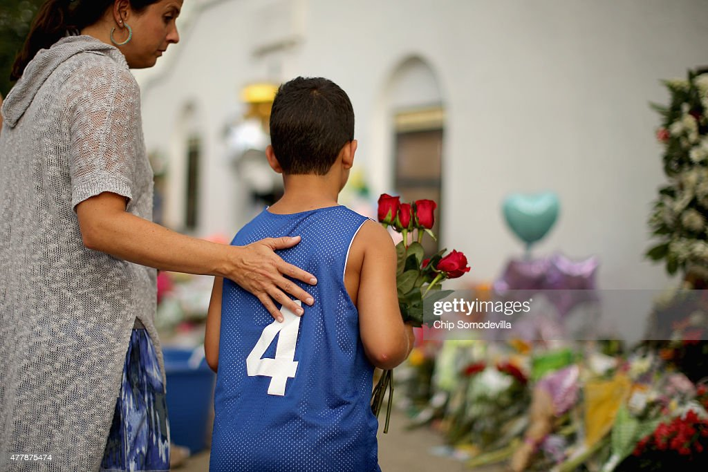 Mourners continue to gather and place flowers outside the historic Emanuel African Methodist Church where nine people were shot to death earlier this...