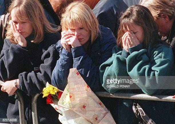 Mourners cry as the coffin of Diana Princess of Wales passes through Mall Avenue in London on its way to Westminster Abbey where the funeral will be...