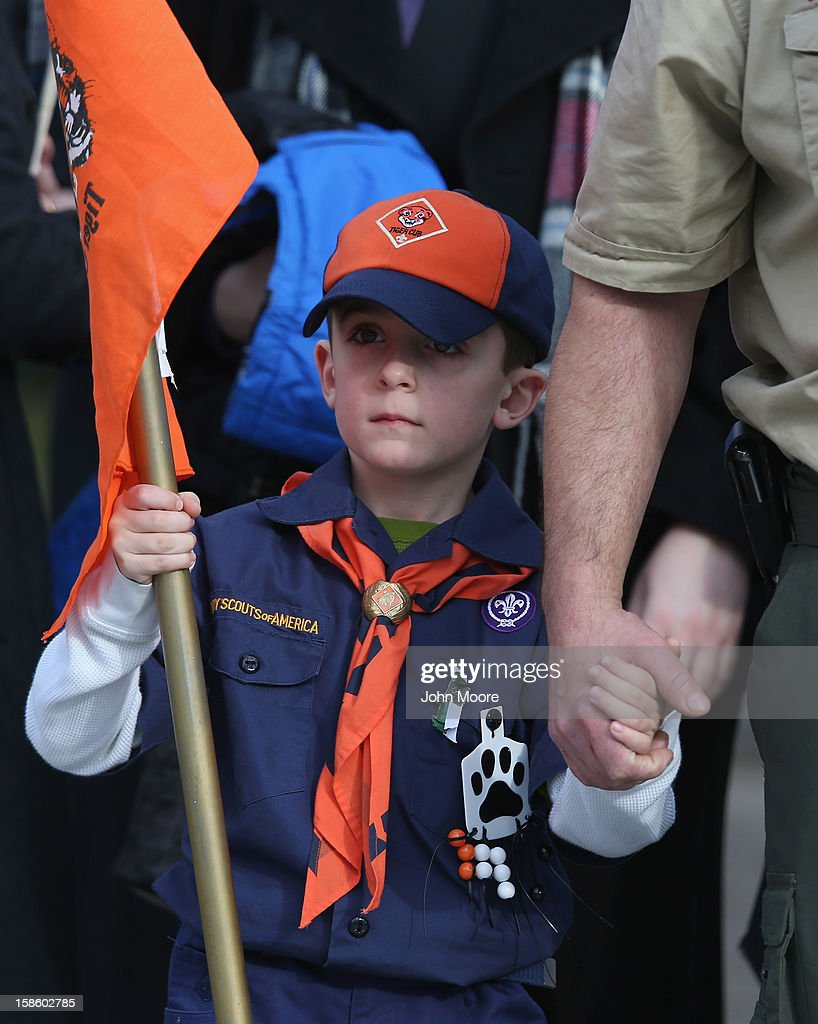 Mourners depart a funeral for Benjamin Wheeler, 6, at the Trinity Episcopal Church on December 20, 2012 in Newtown, Connecticut. Benjamin, a member of Tiger Scout Den 6, was killed when 20 children and six adults were massacred at Sandy Hook Elementary School last Friday. Six services were held for students and teachers in the Newtown area Thursday.