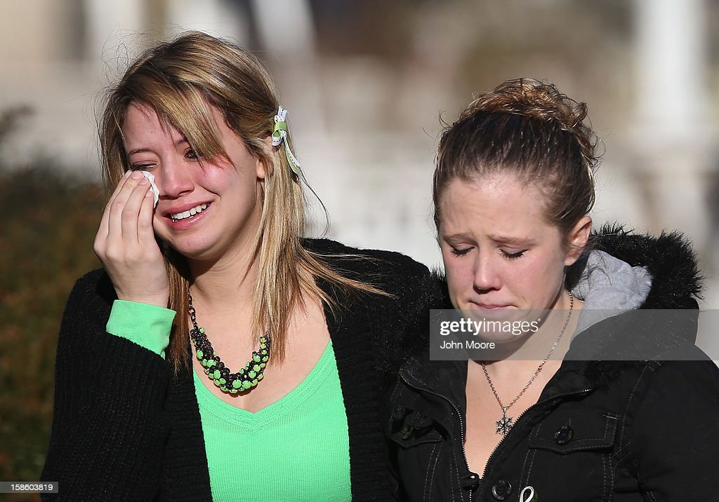 Mourners depart a wake for Jesse Lewis, 6, on December 20, 2012 in Newtown, Connecticut. Jesse was killed when 20 children and six adults were massacred at Sandy Hook Elementary School last Friday. The boy is scheduled to be buried at a private service Friday.