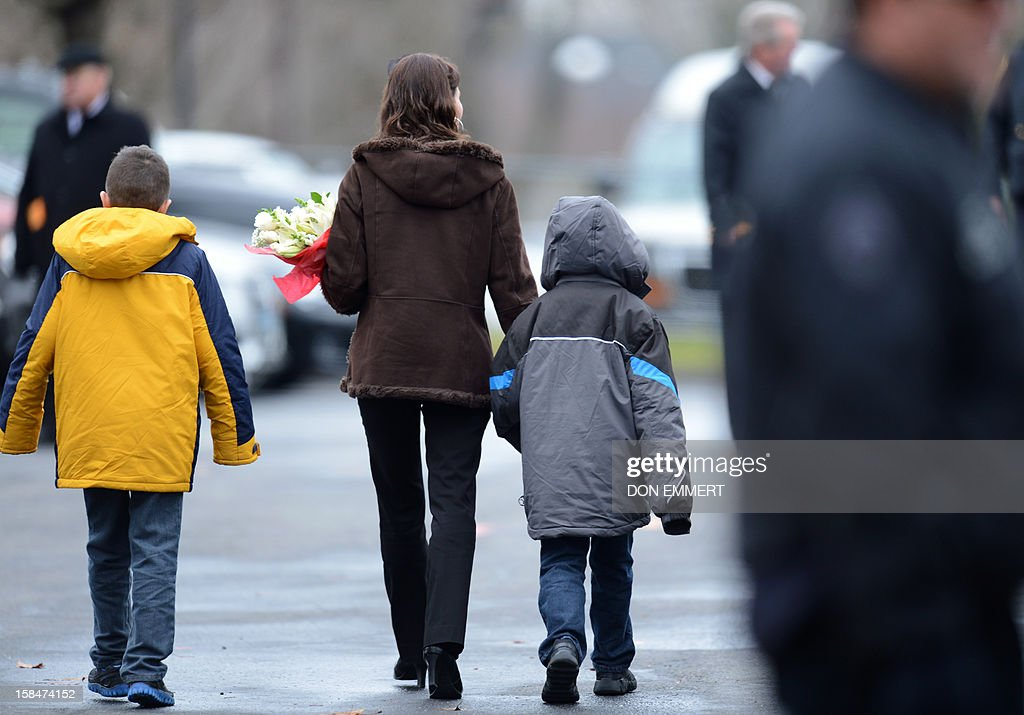 Mourners depart following services for six year-old Noah Pozner, who was killed in the December 14, 2012 shooting massacre in Newtown, Connecticut, at Abraham L. Green and Son Funeral Home on December 17, 2012 in Fairfield, Connecticut. Today is the first day of funerals for some of the twenty children and seven adults who were killed by 20-year-old Adam Lanza on December 14, 2012. AFP PHOTO / Don EMMERT