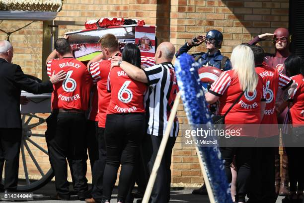 Mourners dressed as super heroes salute Bradley Lowery's coffin as it is carried into St Joseph's Church on July 14 2017 in Hartlepool England...