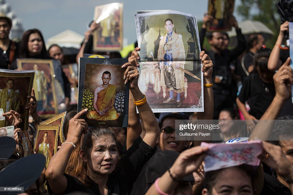 Mourners dressed in black gather around the Grand Palace while carrying several portraits of the king as they wait to perform the Royal Anthem at Sanam Luang. More than 100.000 mourners from across Thailand came during the long week end holiday to sing the Thai Royal Anthem to pay respect to the late Thailand King Bhumibol Adulyadej who passed away on October 13, 2016 at Siriraj Hospital. Thai King Bhumibol Adulyadej was the world's longest reigning monarch and died at the age of 88 after a long illness since several years, he was the most unifying symbol for Thai people and leaving behind him a divided country under military control.