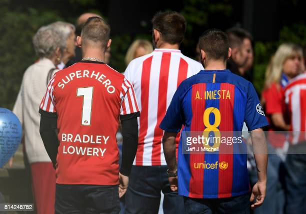 Mourners dressed in football shirts arrive for the funeral of six year old Sunderland FC fan Bradley Lowery at St Joseph's Church on July 14 2017 in...