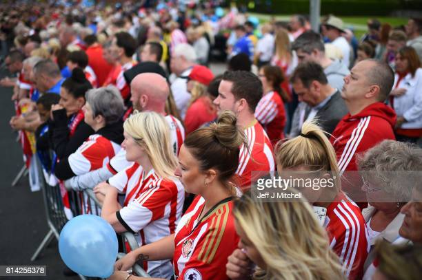 Mourners dressed in football shirts during for the funeral of six year old Sunderland FC fan Bradley Lowery at St Joseph's Church on July 14 2017 in...