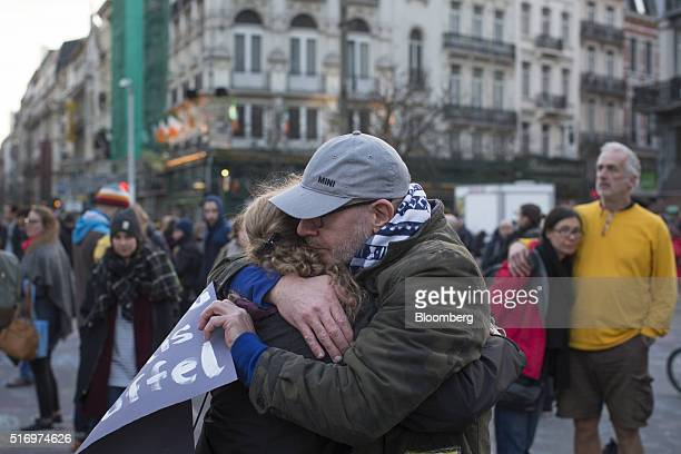 Mourners embrace at Beursplein square in Brussels Belgium on Tuesday March 22 2016 Explosions ripped through the Brussels airport departure hall and...