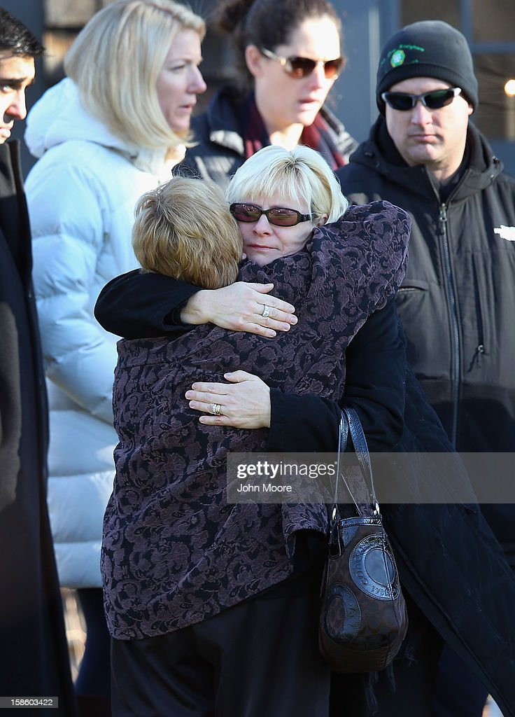 Mourners embrace while attending a wake for Jesse Lewis, 6, on December 20, 2012 in Newtown, Connecticut. Jesse was killed when 20 children and six adults were massacred at Sandy Hook Elementary School last Friday. The boy is scheduled to be buried at a private service Friday.