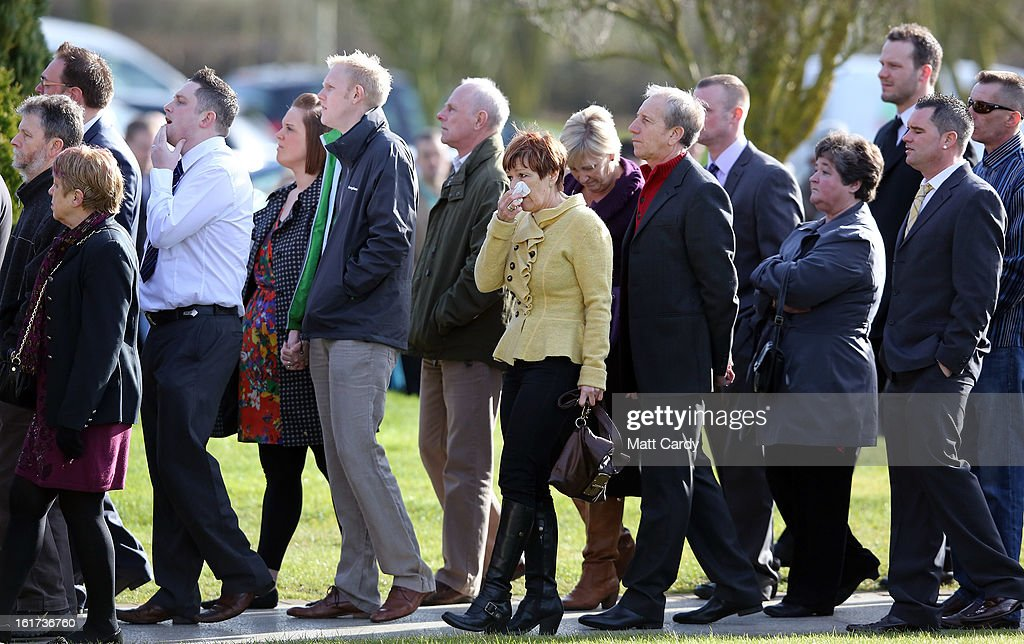 Mourners enter the chapel after the hearse carrying the two coffins containing the body of Ross Simons and his wife Clare arrives at Westerleigh Crematorium for their joint funeral on February 15, 2013 in Bristol, England. The couple were killed when their tandem bike collided with a car in Hanham. A 38-year-old man has been charged with two counts of causing death by dangerous driving after Ross Simons, 34, and Clare, 30, died at the scene of the crash in Bristol on January 27, 2013.
