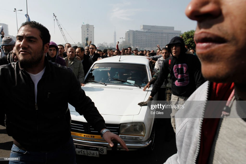 Mourners escort a hearse through Cairo's Tahrir Square after a funeral for two protesters killed during violent clashes with Egyptian security forces in the Egyptian capital in previous days, at the Omar Makram Mosque, on February 4, 2013 in Cairo, Egypt. The funeral, held for Egyptian protesters Mohammed al Guindy and Amr Saad who were killed during fighting with riot police at protests near Cairo's Tahrir Square and outside Egypt's Presidential Palace. Protests have continued across Egypt nearly more than one week after the second anniversary of the Egyptian Revolution that overthrew former President Hosni Mubarak on January 25, 2011.