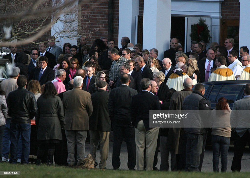 Mourners exit St. Rose of Lima Church in Newtown, Connecticut, on Wednesday, December 19, 2012, after funeral mass for Caroline Previdi, 6, who was killed in the Sandy Hook Elementary School shooting on Friday.