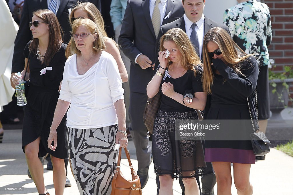 Mourners file out of St. Cecilia's Church following the funeral mass for Amy Lord in Wilbraham, Mass., July 30, 2013.