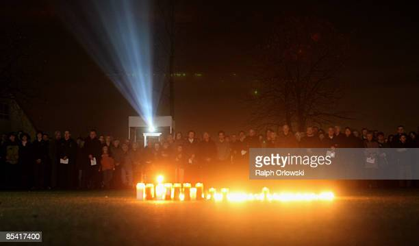 Mourners follow a church service for the victims of a school shooting outside a municipal hall on March 13 2009 in Leutenbach near Winnenden Germany...