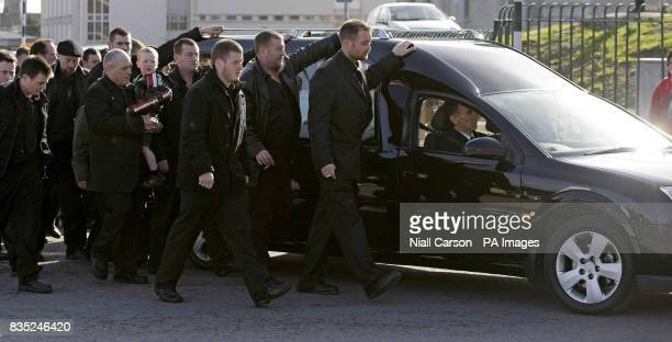 Mourners follow a hearse carrying the coffin of James McDonagh during his funeral and that of brothers Anthony and Martin McDonagh at Our Lady of...