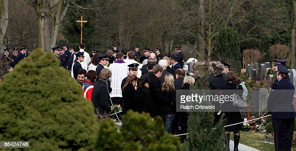 Mourners follow the coffin during the funeral of one of the victims of a high school shooting on March 14 2009 in Winnenden Germany 17 year old Tim...