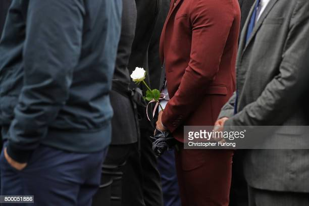 Mourners follow the funeral cortege of Manchester attack victim Alison Howe as it arrives at St Anne's Church on June 23 2017 in Oldham England...