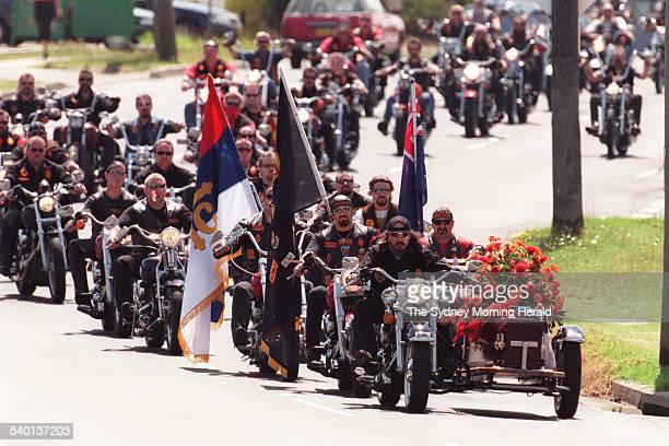 Mourners form a funeral procession for slain Bandidos member Sasha Milenkovic his coffin transported in a sidecar en route to his funeral service at...