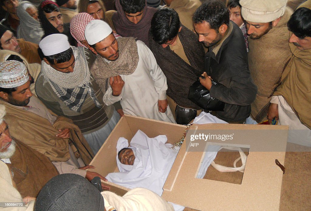 Mourners gather around the coffin of a Pakistani Frontier Constable, killed in a suicide bombing attack in Sari Norang, during a funeral in Kohat on February 3, 2013. Suicide bombers attacked a military checkpost in Pakistan's troubled northwest on February 2, killing 13 soldiers and 11 civilians, officials said, in an assault claimed by the Taliban. AFP PHOTO/Basit GILANI