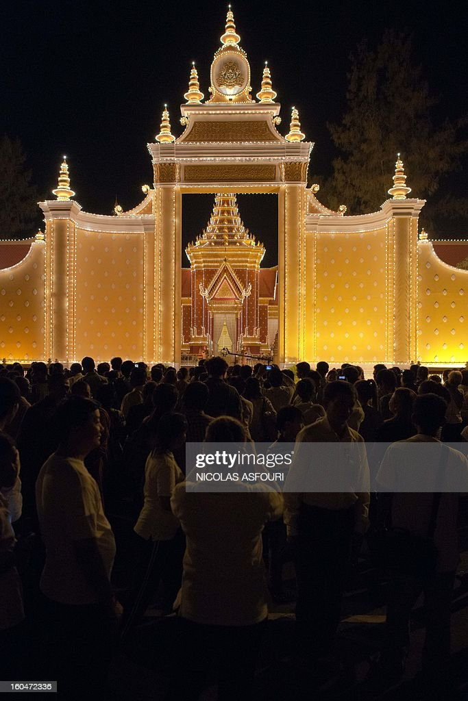 Mourners gather at a crematorium where a coffin bearing the remains of Cambodia's late King Norodom Sihanouk is placed, near the Royal Palace in Phnom Penh on February 1, 2013. Sihanouk, who abdicated in 2004 after steering Cambodia through six decades marked by independence from France, civil war, the murderous Khmer Rouge regime and finally peace, died of a heart attack in Beijing on October 15, 2012 and will be cremated on February 4. AFP PHOTO/ Nicolas ASFOURI