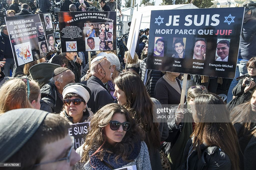 Mourners gather at a Jerusalem cemetery on January 13 2015 to attend the funeral of four Jews killed in an Islamist attack on a kosher supermarket in...