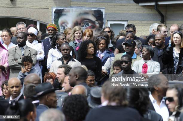 Mourners gather at the funeral of antigun campaigner Pat Regan Marlborough Grange Leeds at All Hallows Church in the Hyde Park area of Leeds