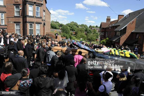Mourners gather at the funeral of antigun campaigner Pat Regan of Marlborough Grange Leeds at All Hallows Church in the Hyde Park area of Leeds