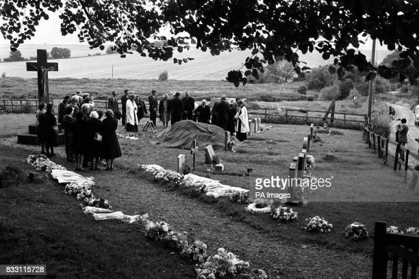 Mourners gather at the graveside of Hungerford massacre victim Eric Vardy during the funeral service at Great Shefford near Hungerford