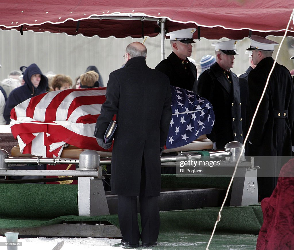 Mourners gather at the gravesite of Marine Cpl Mark D Kidd of Milford Michigan for his burial service at Fairview Cemetery February 3 2007 in...