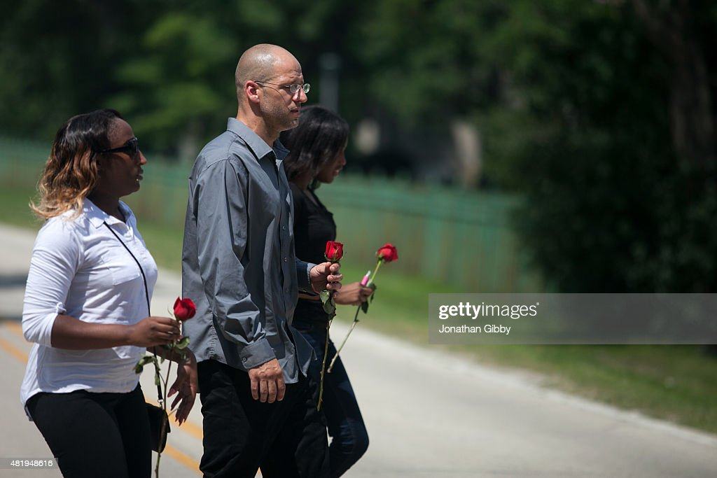 Mourners gather for the burial of Sandra Bland at Mt Glenwood Memorial Gardens West cemetery on July 25 2015 in Willow Springs Illinois Bland's death...