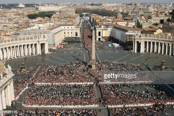 Mourners gather for the procession of the body of Pope John Paul II in St Peter's Square April 4 2005 in Vatican City The Pope's body will be viewed...