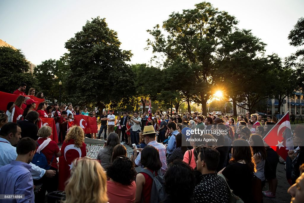 Mourners gather in Dupont Circle to hold a vigil for the victims of the Istanbul Airport terrorist attack Washington, USA on June 29, 2016.