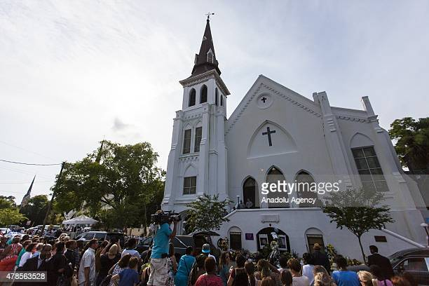 Mourners gather in front of Emanuel African Methodist Episcopal Church a historic black church where Dylann Roof a self declared White Supremacist...